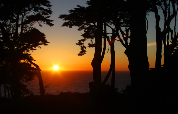The sun sets over the Pacific off Land's End, San Francisco, California (9/24/2010). Photo by Bill Hubick.